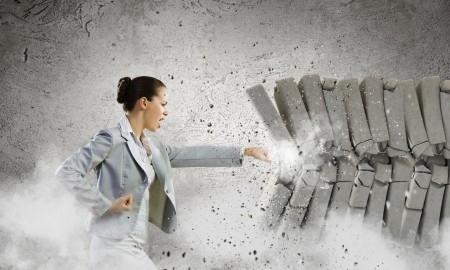 businesswoman-breaking-bricks-with-hand